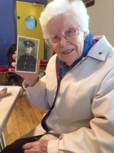 Joy Allen with a photograph of her father who was a special constable during WW1, working at the Caudite Factory. He would have to frisk the workers to make sure they didn't take anything flammable into the factory.
